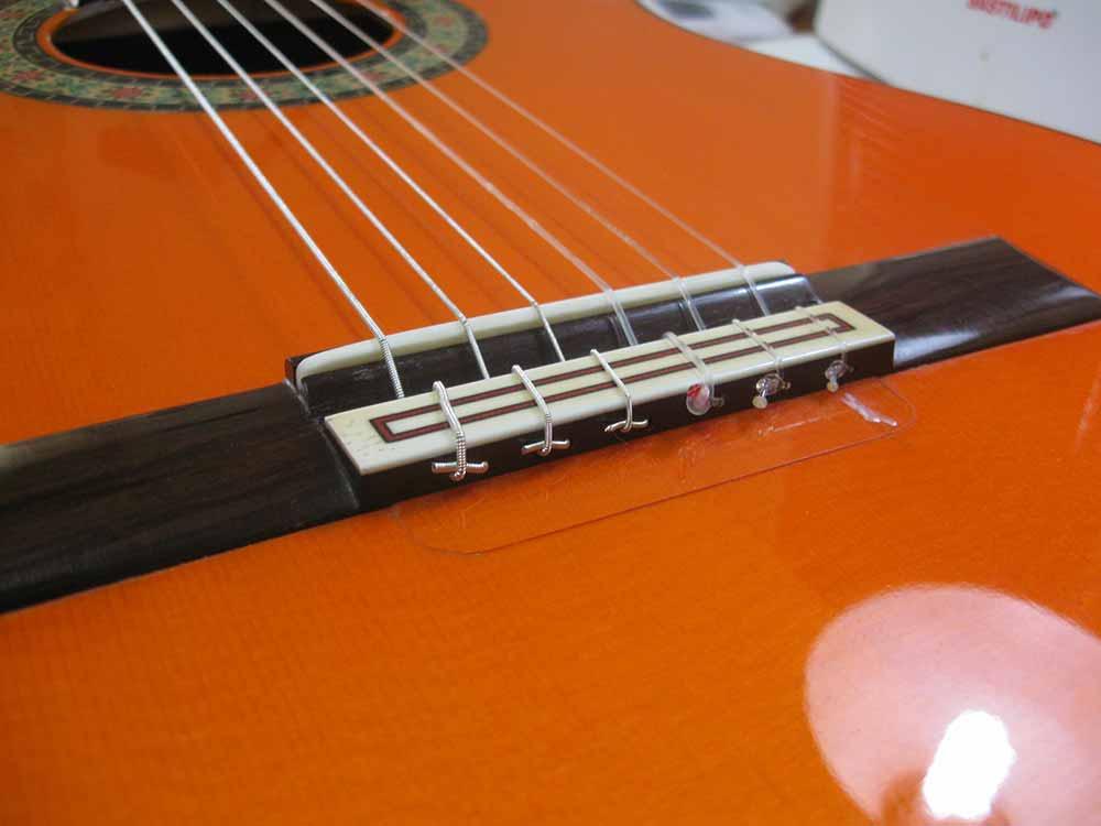 puente reparacion guitarra luthier sevilla fernando moreno